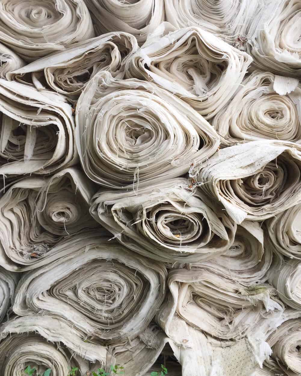 Large rolls of white textile fabric for manufacturing